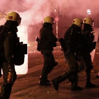 Greece receives two-month extension on its bailout as 300 arrested in protests