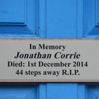 A plaque has been erected in the doorway where Jonathan Corrie died