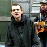 Homeless Love/Hate Jesus raver sings with buskers on Grafton Street