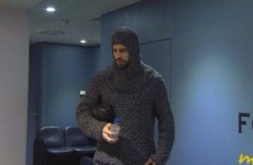 Gerard Pique has shown up at the Nou Camp dressed like a knight
