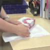 This guy's gift wrapping skills are far superior to your paltry efforts