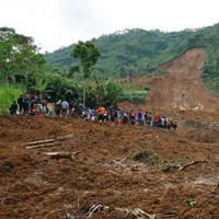 Woman searches for her children among 12 family members buried in landslide