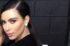 Kim Kardashian cropped her own daughter out of a selfie and the internet freaked out