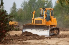 Man arrested after bulldozer and cash found in search
