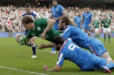 Andrew Trimble crashes over the line to score against Italy during the 2014 Six Nations.