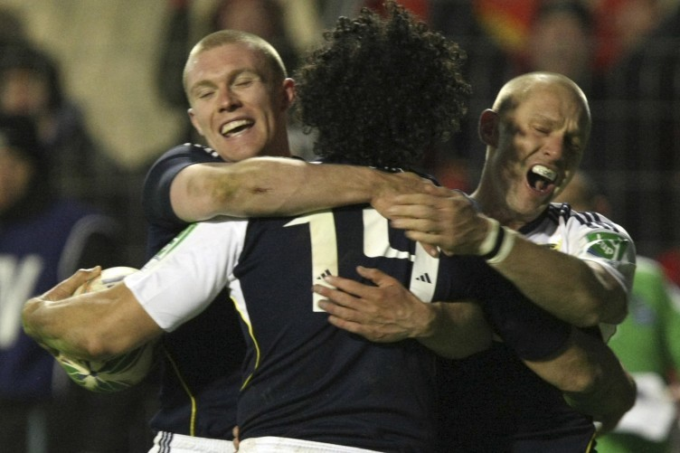 Doug Howlett, centre, celebrates Munster's fourth try against Perpignan in 2009 with Keith Earls and Paul Warwick.