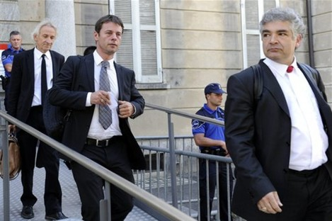 The attorneys of the three eco-anarchists leave the federal criminal court in Bellinzona, Switzerland, Friday, 22 July 2011.