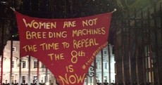 Pro-choice activists tie pair of giant red knickers to Dáil gates