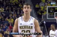 Double plane crash survivor Austin Hatch scores his first college basketball point