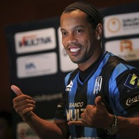 Ronaldinho has been threatened with the sack by his club cos he's gone missing