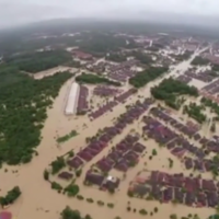 Malaysia PM under fire for playing golf with Obama while 120k flee floods