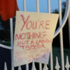 Lipstick 'traitor' sign hung on Áras gates as President rubber-stamps contentious bill
