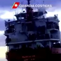 Runaway ship with 900 refugees on board stopped from striking Italian coast