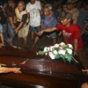 First victim of doomed AirAsia flight buried