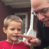 Dad of the Year pulls his son's tooth with a golf club and dental floss