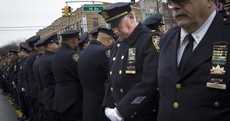 Cops protest against NY mayor at slain police officer's funeral