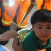 Adorable toddler gets stuck in washing machine and has to be rescued