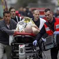 Manhunt for gunmen in Paris after twelve killed in massacre at satirical magazine offices