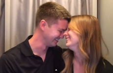 Woman tells husband she's pregnant in photo booth, makes him cry