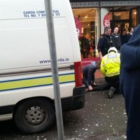 Shoppers watch as two men are arrested on city street for drugs offences