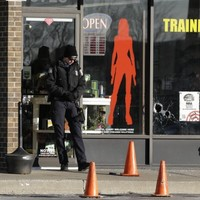 Multiple people shot in suspected robbery at Kansas gun shop