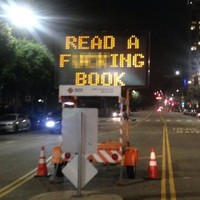 """Someone hacked an LA traffic sign to say """"Read a f***ing book"""""""