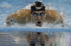Phelps wins men's 200 butterfly at worlds