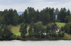 Norway massacre gunman 'surrendered with his hands up'