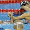 Lochte swims into the record books