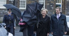 Are the people who run the country laughing at this woman being attacked by her brolly?