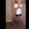 Baby-holding dad demonstrates how to successfully put on pants with no hands