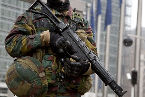 A Belgian soldier patrols in front of EU headquarters in Brussels today.
