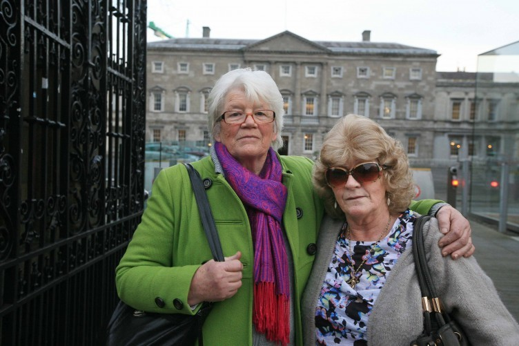 Diane Croghan a survivor of the Summer Hill Mercy Convent and Martina Keogh a survivor of the Magdalene Lauundrey ,pictured outside the Dail