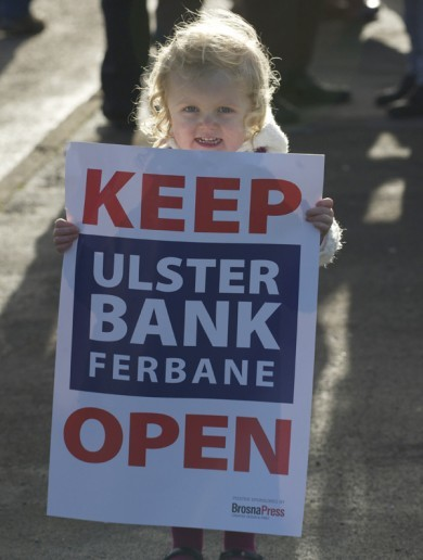 A community is taking to the streets today to stop its local bank from closing