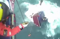 Dramatic video shows fishermen saved moments before their boat sank