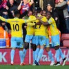 Chamakh and Sanogo combine to stun Southampton as Long fractures rib