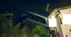 A 15 foot drop into a roadside fence ... but no-one was injured in this nasty-looking crash