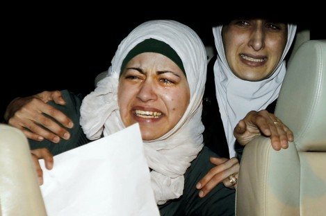 The sister, right, and wife, left, of Jordanian pilot, Lt. Muath al-Kaseasbeh, who is held by the Islamic State group militants.