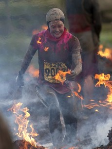 Would you run through fire and carry a cross? That's what it takes to finish the world's toughest race