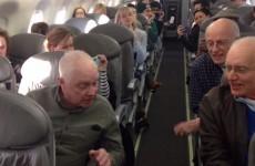 Incredible barbershop quartet serenades fellow passengers during plane delay
