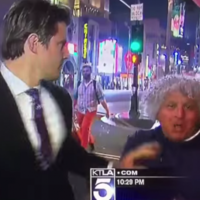 Watch a news reporter mercilessly deal with a would-be videobomber