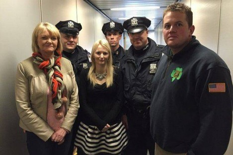 Police officers welcomed Hanrahan's mother Rosemary and wife Emma Holland when they arrived in the US.