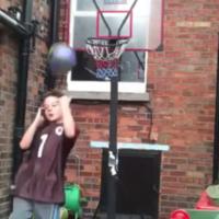 Dublin kid accidentally nails incredible basketball shot (while talking to his mam)