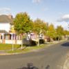 Men wearing high-vis jackets threaten woman (80s) at her home