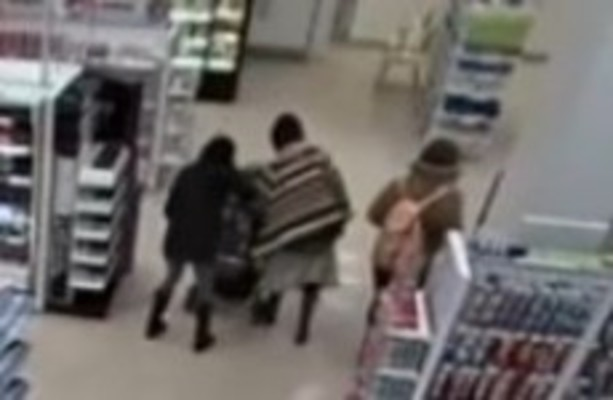 """Woman grabs toddler by throat saying """"that baby would ..."""