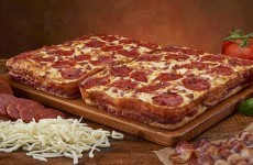 US pizza chain introduces bacon-wrapped pizza