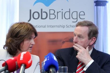 Joan Burton and Enda Kenny at the launch of a JobBridge report in 2013.