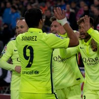 Luis Suarez scores twice on his return to England... but Messi proves he's human