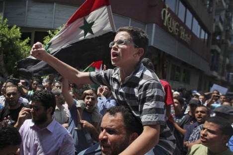 A protest against the Syrian government by pro-reform supporters in Cairo, Egypt, on 5 August.