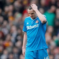 John O'Shea pulls back Falcao in penalty area, referee sends off Wes Brown